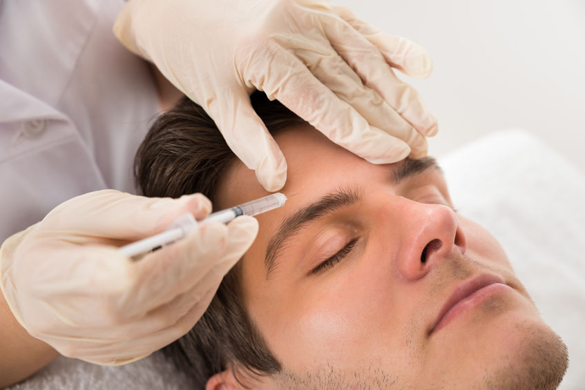 photo of a man getting a Botox treatment